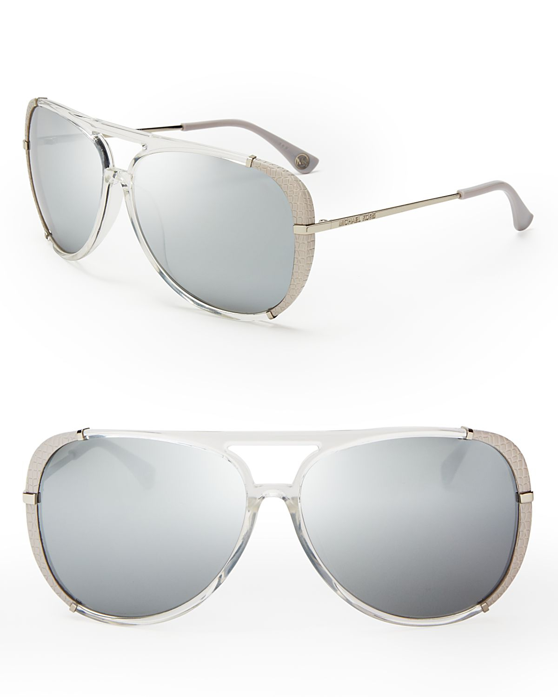 68b9d7b94e Lyst - Michael Kors Julia Aviator Sunglasses in Metallic