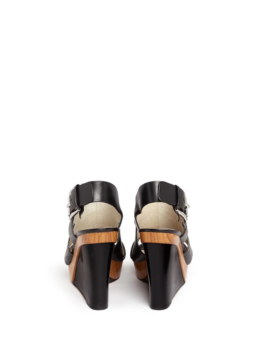 263362cc771 Lyst - MICHAEL Michael Kors  Carla  Leather Platform Wedge Sandals ...