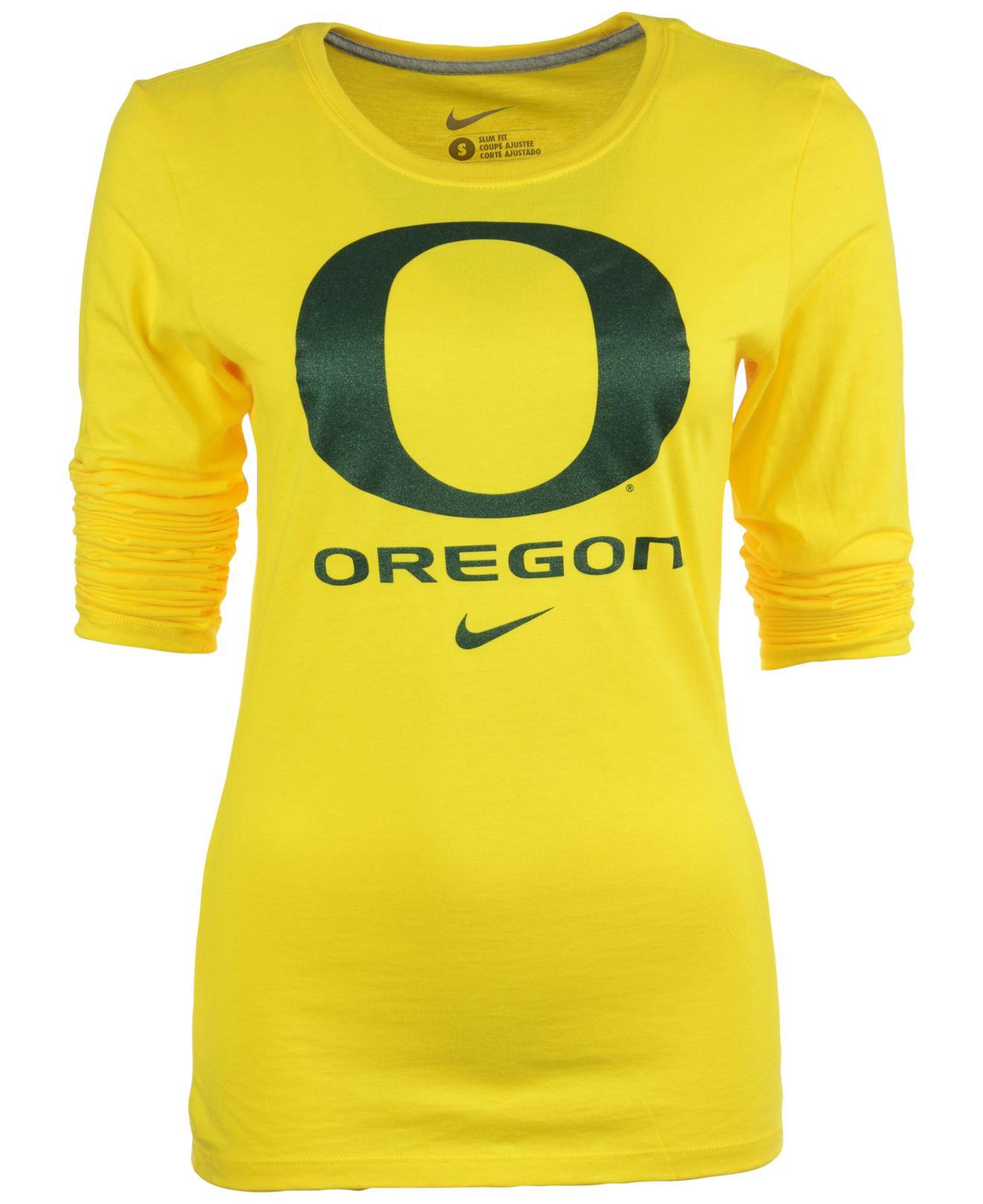 Lyst nike women 39 s long sleeve oregon ducks logo t shirt for Womens yellow long sleeve shirt