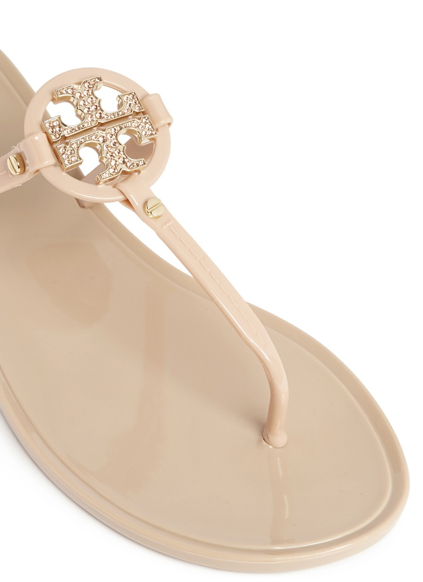 95d7e430bd1816 Lyst - Tory Burch  Mini Miller  Crystal Logo Jelly Thong Sandals in ...