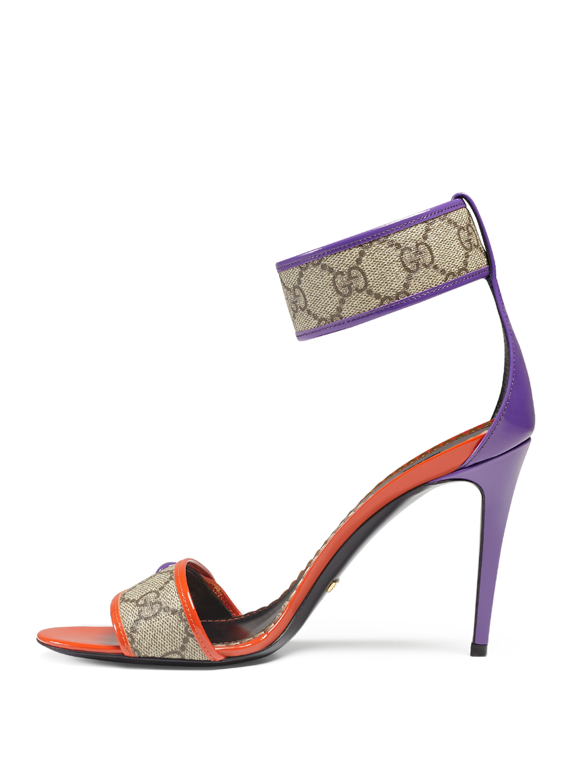 a0240aba6608 Lyst - Gucci Harleth GG Patent Sandals