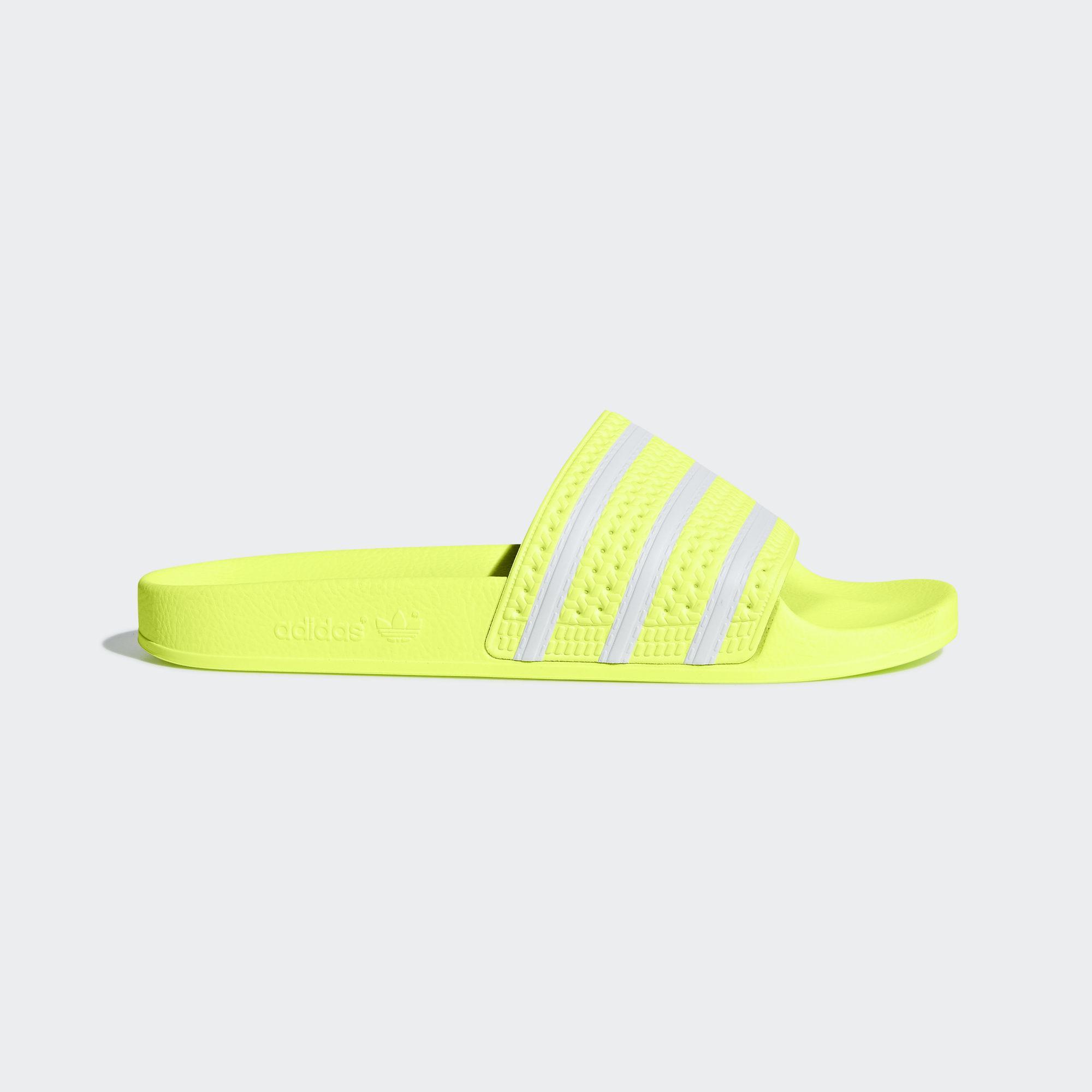 05aab928c adidas Adilette Slides in Yellow - Lyst