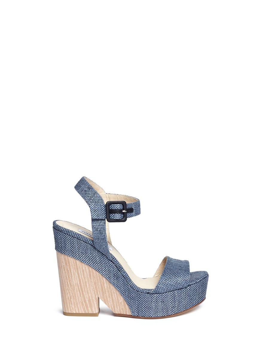 269777ec59e Lyst - Jimmy Choo  nico 125  Wood Effect Wedge Raffia Sandals in Blue