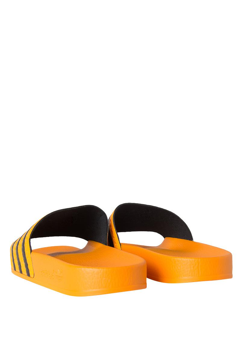bf9e47775 adidas Adilette Slides - Lyst