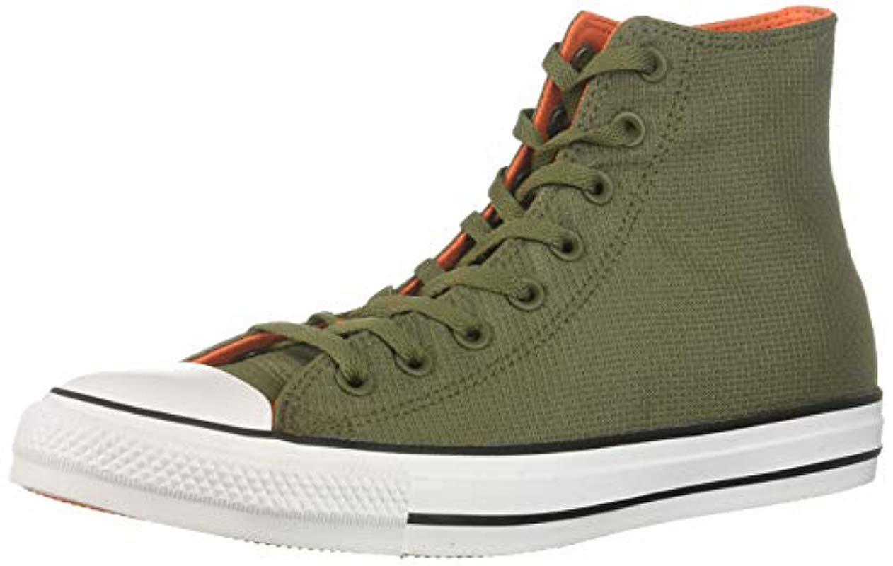 14ac1f6937cd Converse. Men s Green Chuck Taylor All Star Lightweight Nylon High Top  Sneaker