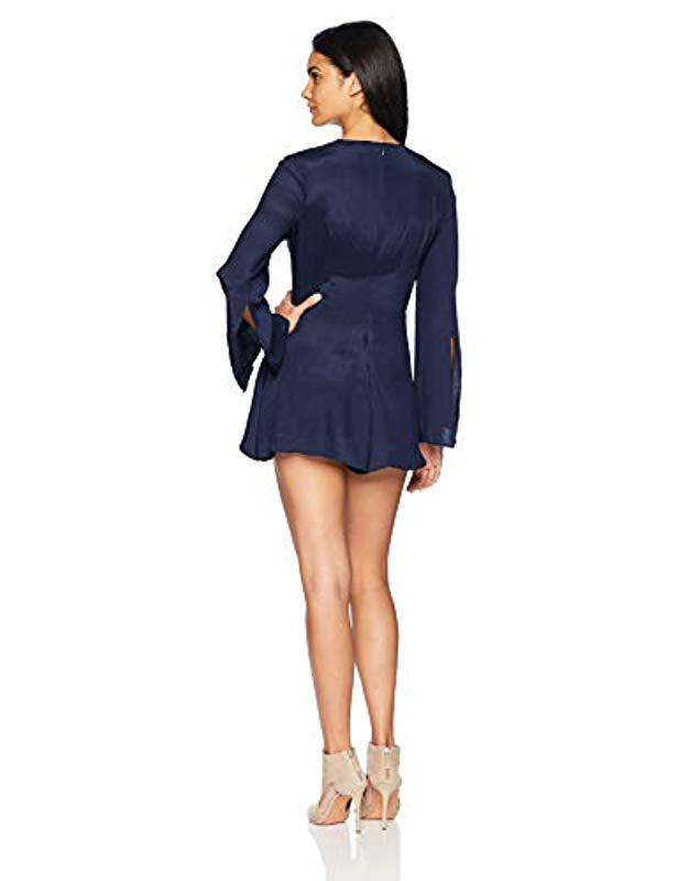 d53de0633ee Lyst - C meo Collective Eminence Draped Wrap Front Long Sleeve Romper  Playsuit in Blue