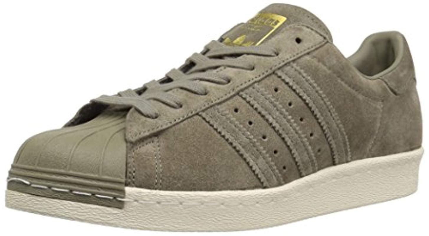 official photos ae4fa f8696 adidas Originals. Men s Superstar 80s Running Shoe