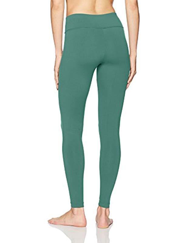 18416ede607db Lyst - Danskin Signature Wide Waist Yoga Ankle Legging in Green
