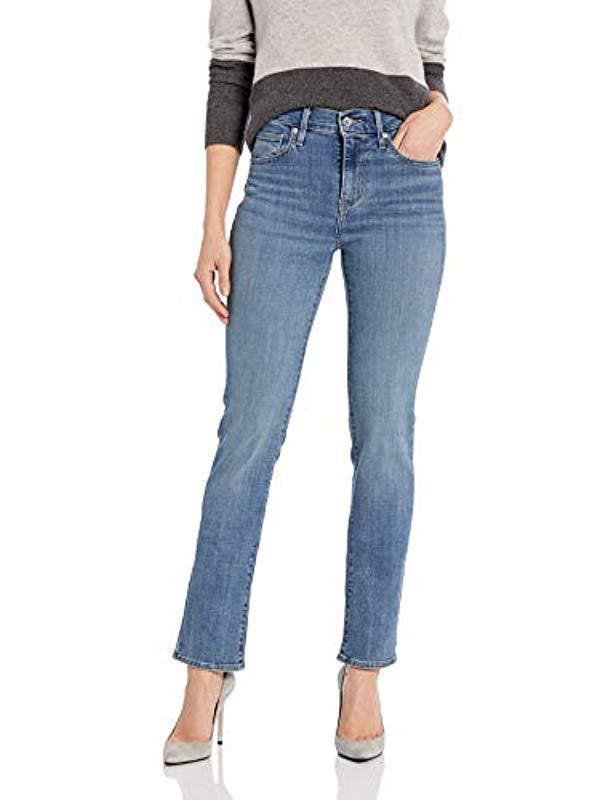 ed658a0960345 Lyst - Levi s 724 High Rise Straight Jeans in Blue - Save 20%