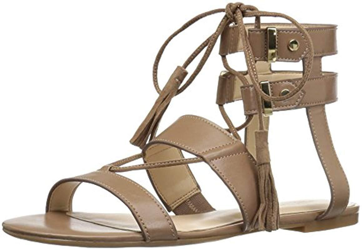 5b2205d3545 Lyst - Nine West Decima Patent Gladiator Sandal in Natural - Save 17%