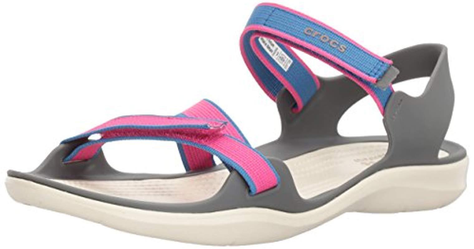 3e63a9bde907 Lyst - Crocs™ Swiftwater Webbing Sandal W Open Toe in Pink
