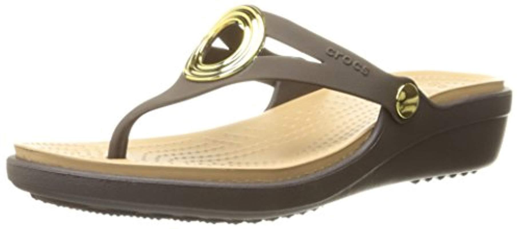 fdfc521fd2c4f Lyst - Crocs™ Sanrah Beveled Circle Wedge Sandal in Metallic - Save ...
