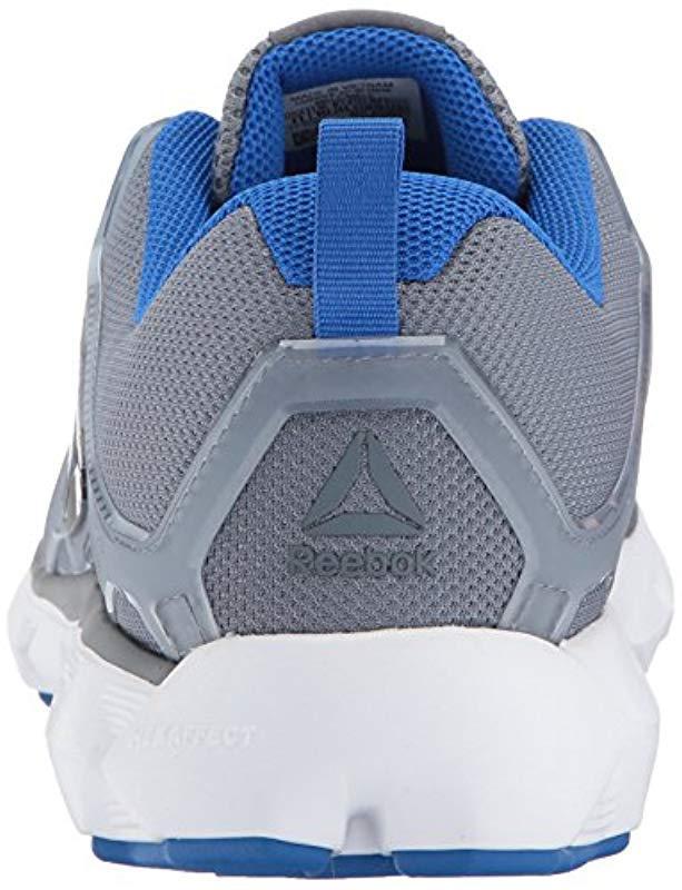 2f9dfbcea05d Lyst - Reebok Hexaffect 5.0 Mtm Running Shoe in Blue for Men - Save 54%