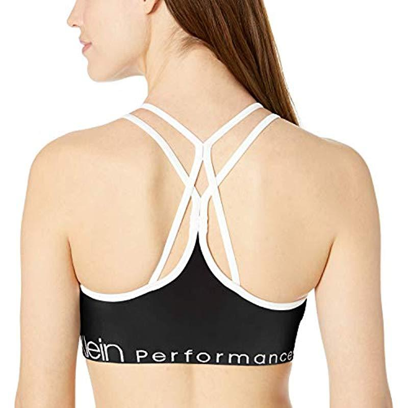 fa59ccbcd4 Calvin Klein - Black Ruched Front Strappy Sports Bra - Lyst. View fullscreen