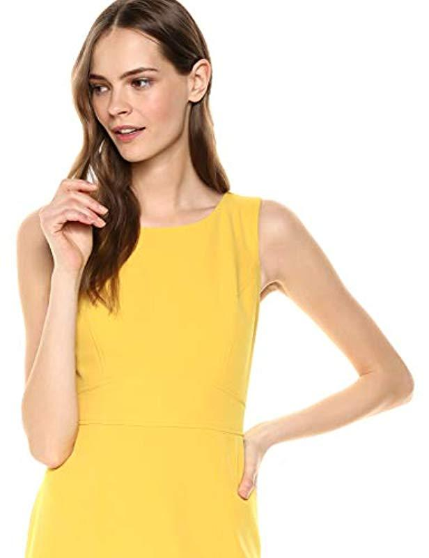 30f9e7e6abb172 Lyst - Kasper Sleeveless Jewel Neck Stretch Crepe Dress in Yellow