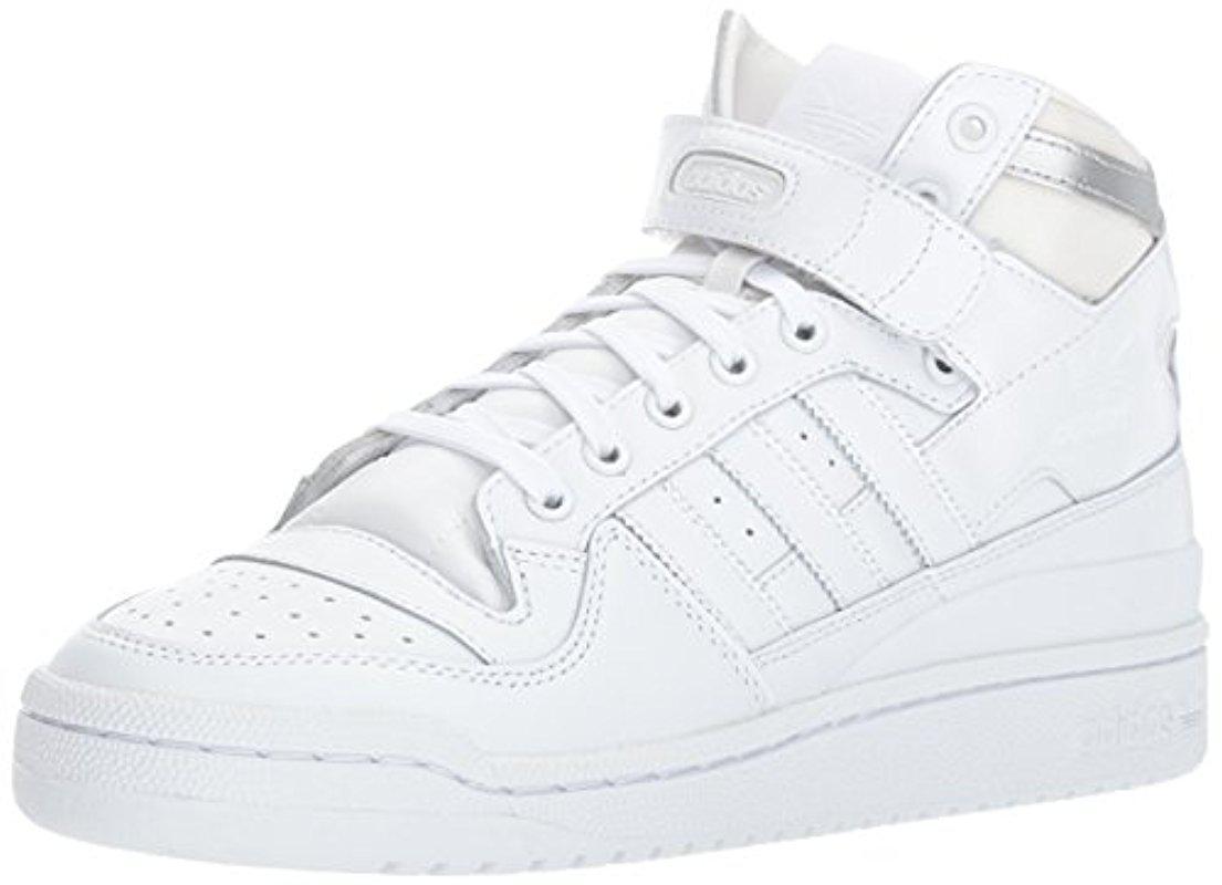 on sale b1745 1f81c adidas Originals. Men s White Forum Mid Refined Fashion Sneaker