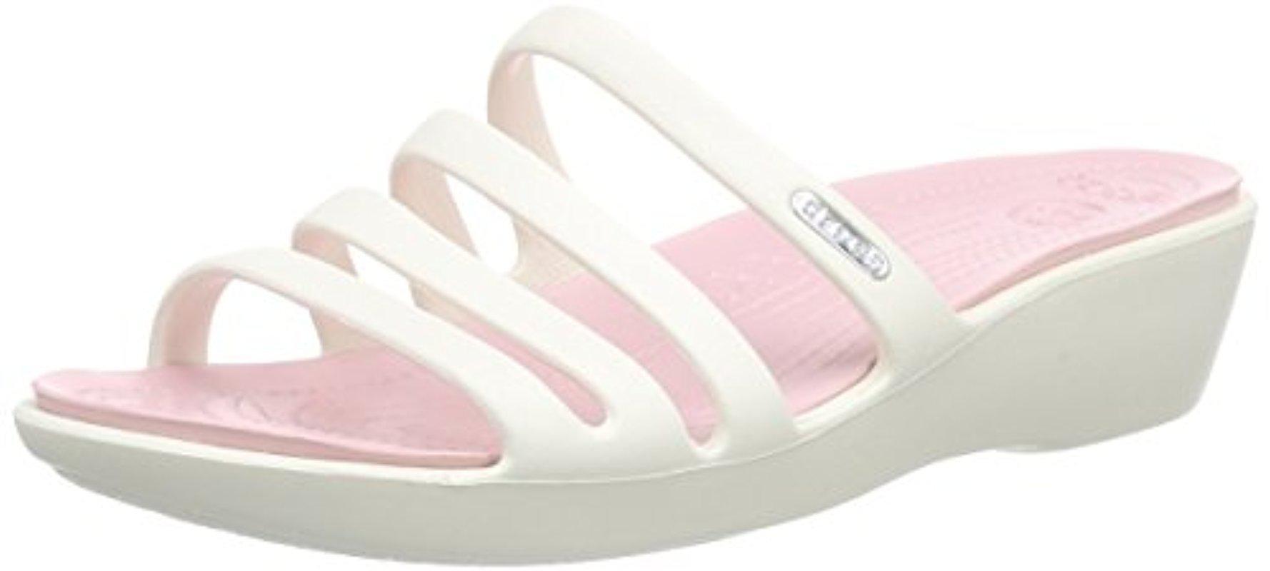 b65eecfdc1e Lyst - Crocs™ Rhonda Wedge Pump in Pink