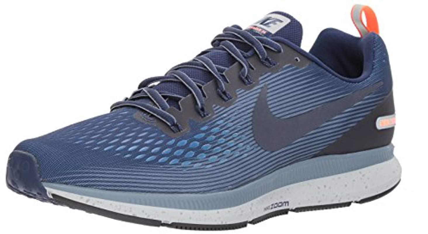 5e57b39c5a72e Nike Air Zoom Pegasus 34 Shield Fitness Shoes in Blue for Men - Lyst