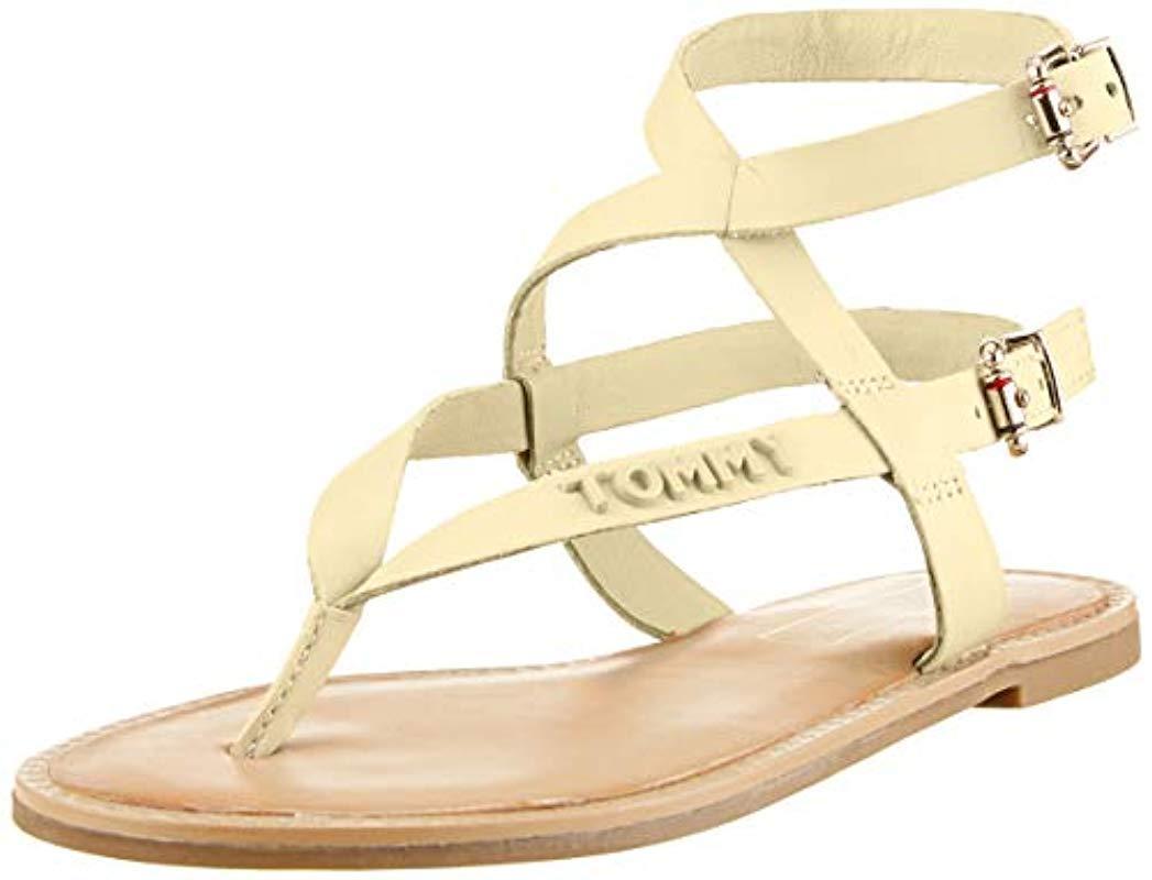 1e97031e5e9182 Tommy Hilfiger. Women s Metallic  s Iconic Flat Strappy Sandal Flip Flops