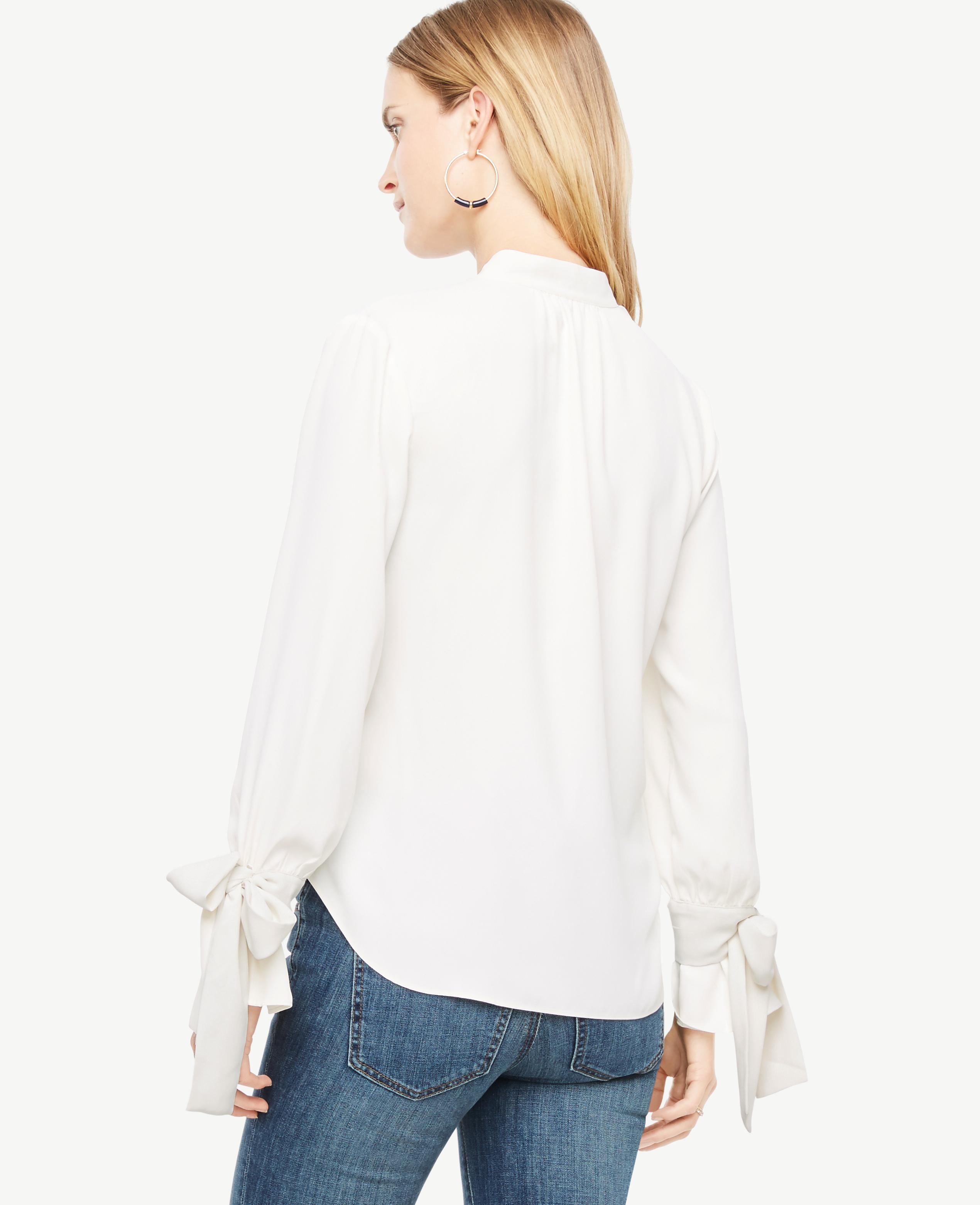 8f7c0db8952850 Ann Taylor Petite Bow Cuff Blouse in White - Lyst