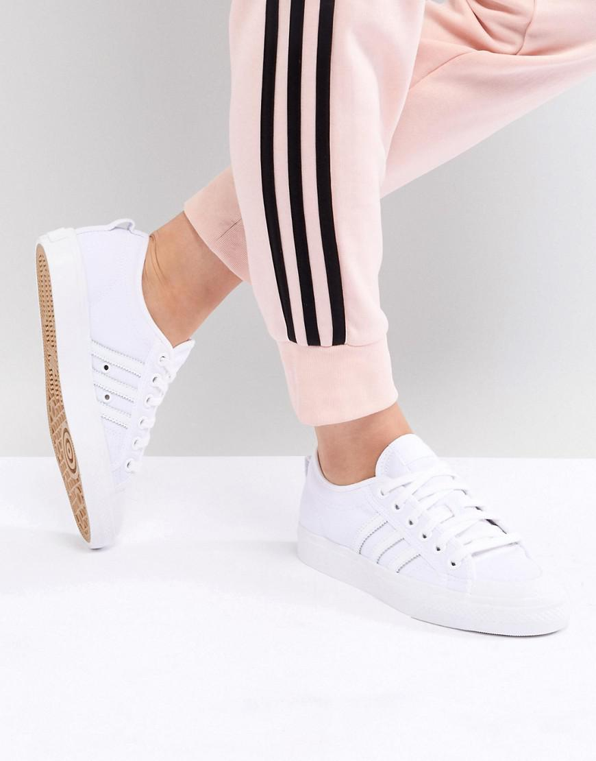 a3d3a36a4bd Lyst - adidas Originals Nizza Canvas Trainers In White in White