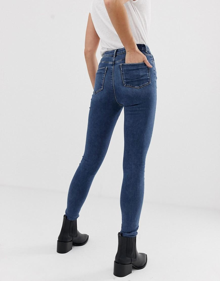 b5c3744aad4 Lyst - ASOS Asos Design Tall Ridley High Waist Skinny Jeans In Mid Wash  Blue in Blue