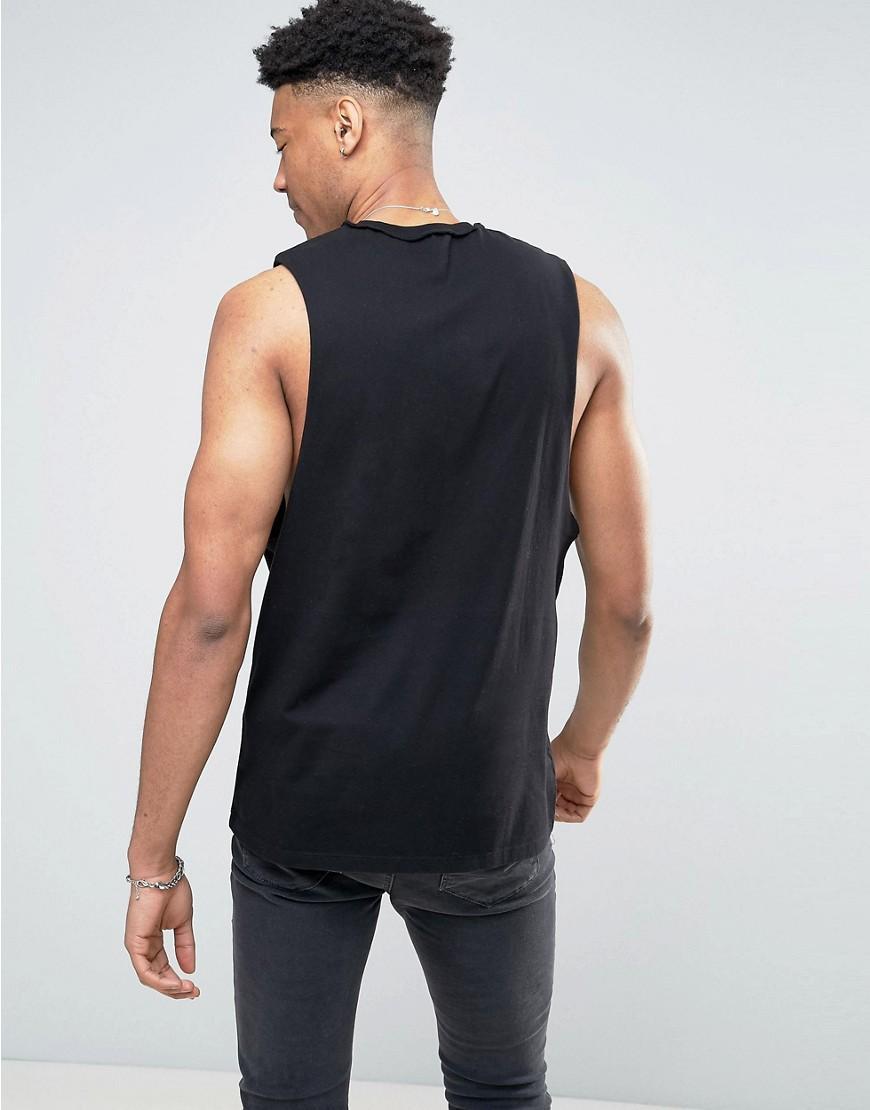 Lyst asos tall nirvana sleeveless band t shirt with for Tall sleeveless t shirts