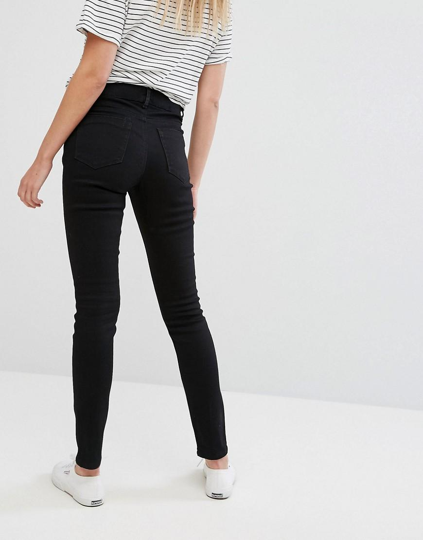 fb4c3533fcb8f Lyst - ASOS Asos Design Maternity Ridley Skinny Jeans In Clean Black With  Under The Bump Waistband in Black - Save 30%