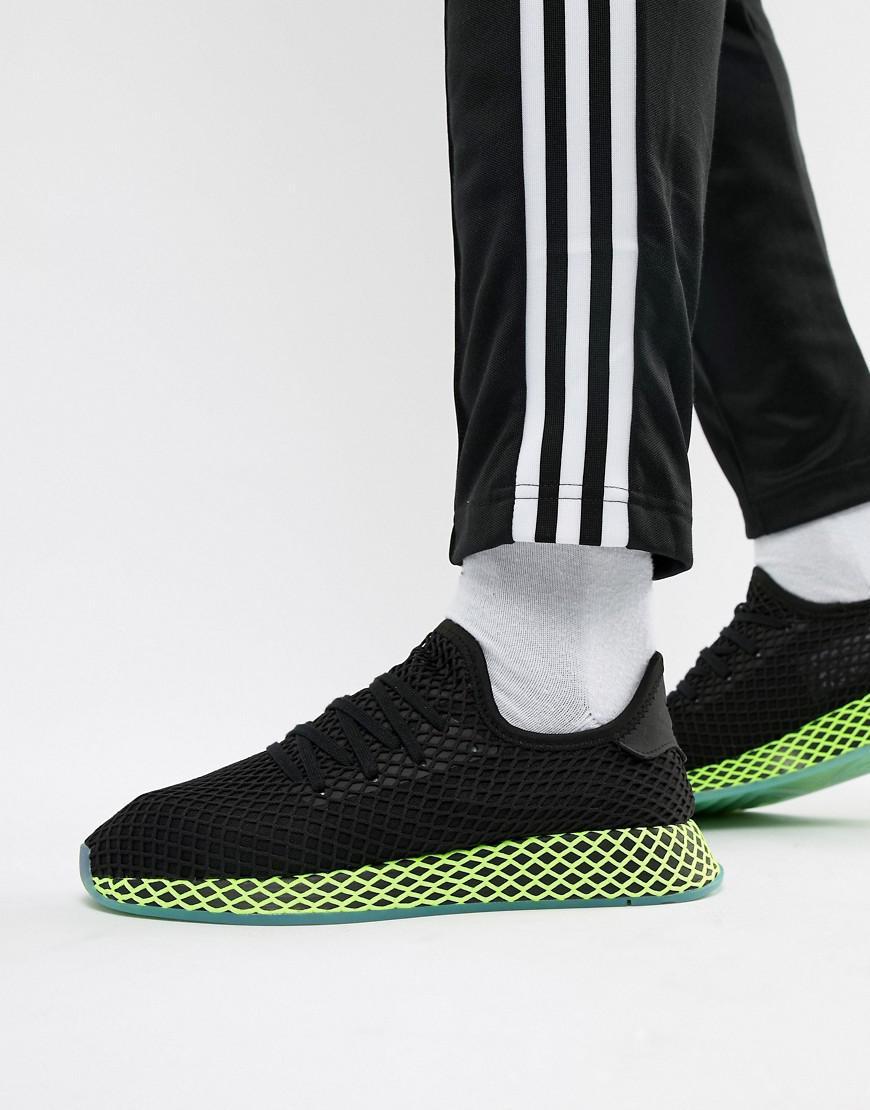 buy popular f2a1b 7f60f Lyst - adidas Originals Deerupt Trainers In Black B41755 in