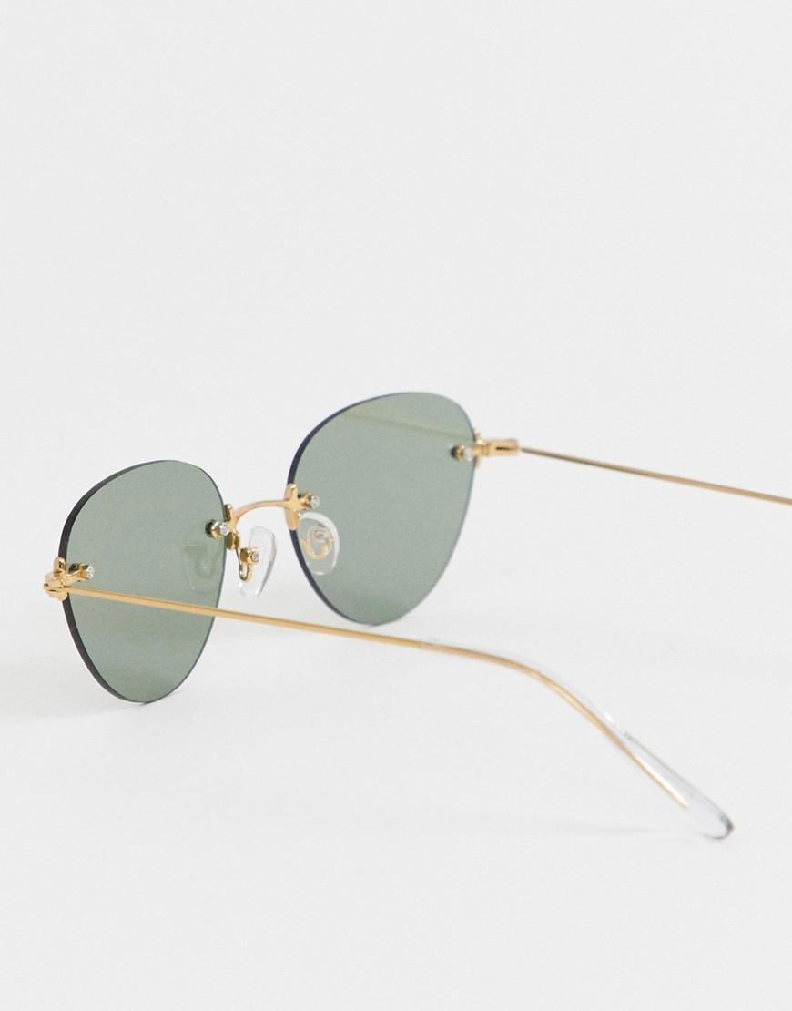 c51e5cbf3 Gafas de sol con montura redonda en dorado brillante y lentes al ...