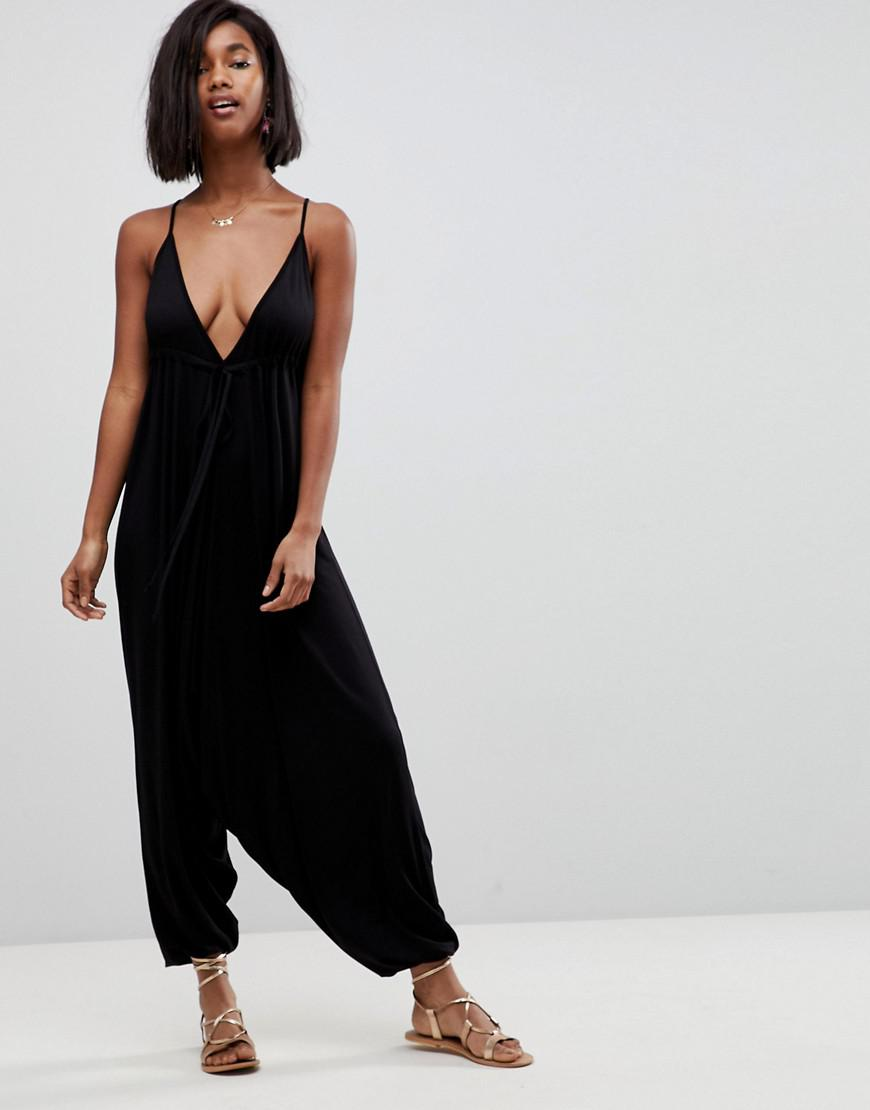 91b9cbcd59 Lyst - ASOS Jersey Halterneck Jumpsuit With Drop Crotch And Harem ...