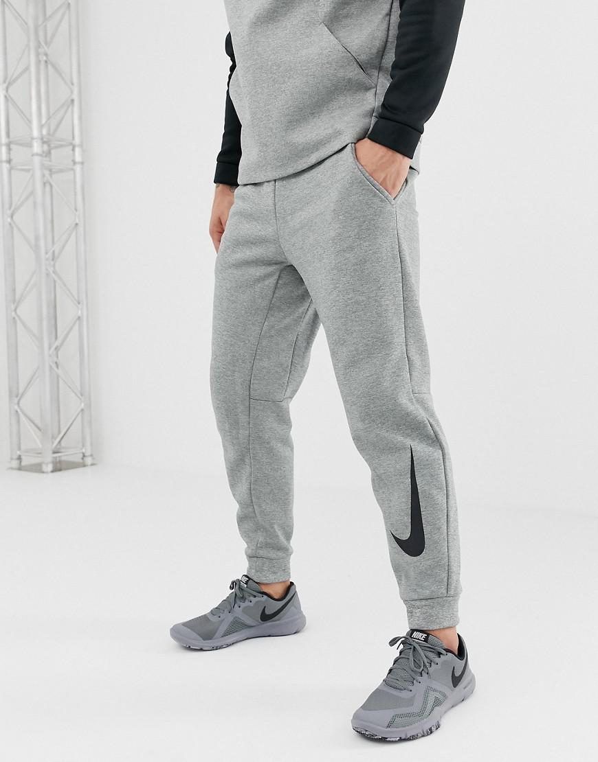 b9a9e32c6 Nike Therma Tapered Swoosh Joggers In Grey 932257-063 in Gray for ...
