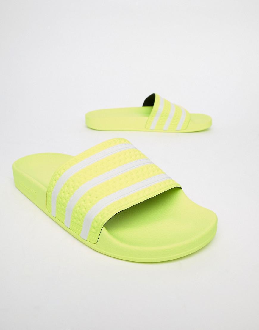 2f5ab391023f Lyst - adidas Originals Adilette Sliders In Yellow B37957 in Yellow ...