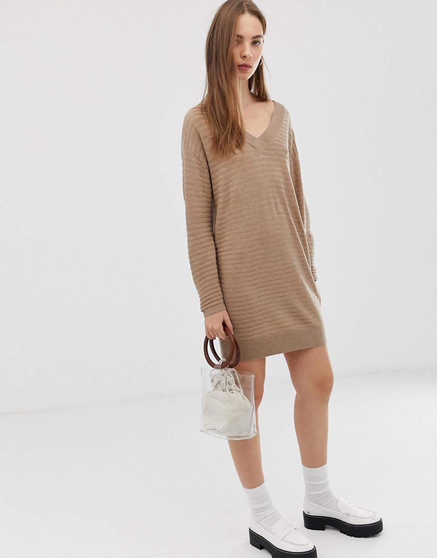 6795f3752c1 ASOS. Women s Ripple Stitch Deep V Mini Jumper Dress In Eco Yarn