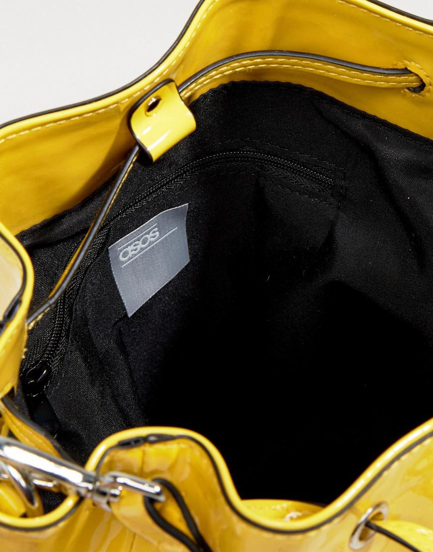 7af81f3ac232f Lyst - ASOS Patent Minimal Bucket Bag With Detachable Straps in Yellow