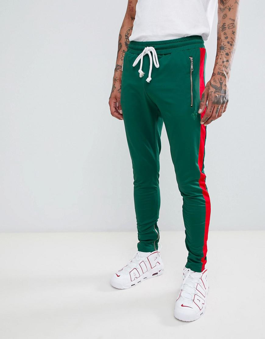 Lyst - Pantalon de jogging skinny bande rouge sur le ct Criminal ... a1160f21c957