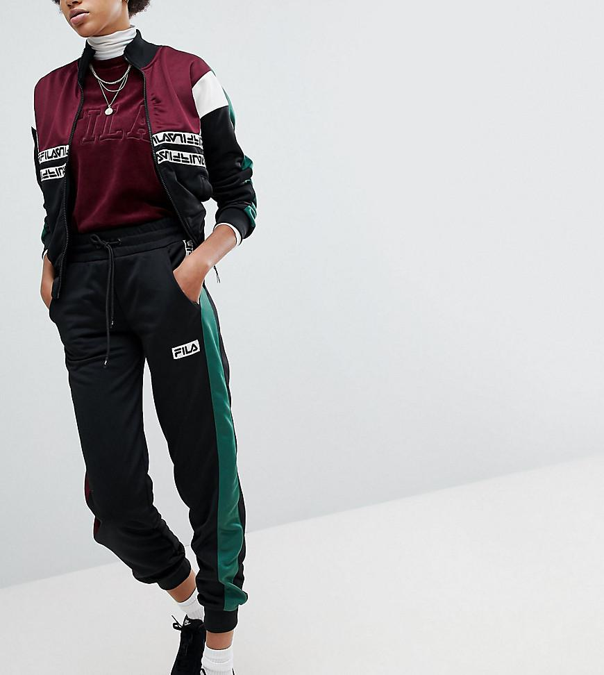 f089f5bdccb2 Fila Tracksuit Bottoms With Contrast Side And Logo Taping in Black ...