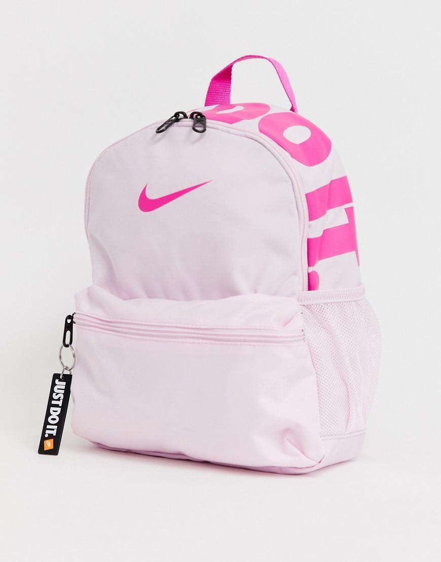5adfc6e6aa Nike. Mini sac dos femme de coloris rose