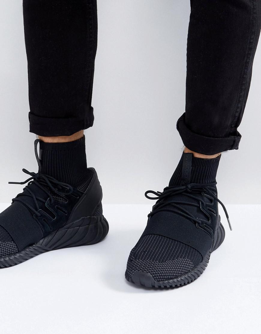 lyst adidas originals tubuläre doom primeknit sneakers in schwarz