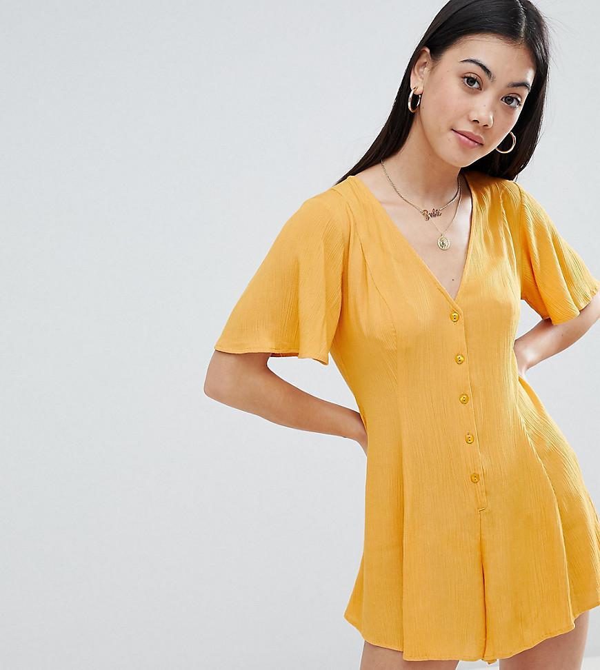 6bc587734507 ASOS. Women s Yellow Asos Design Petite Swing Playsuit With Button Detail