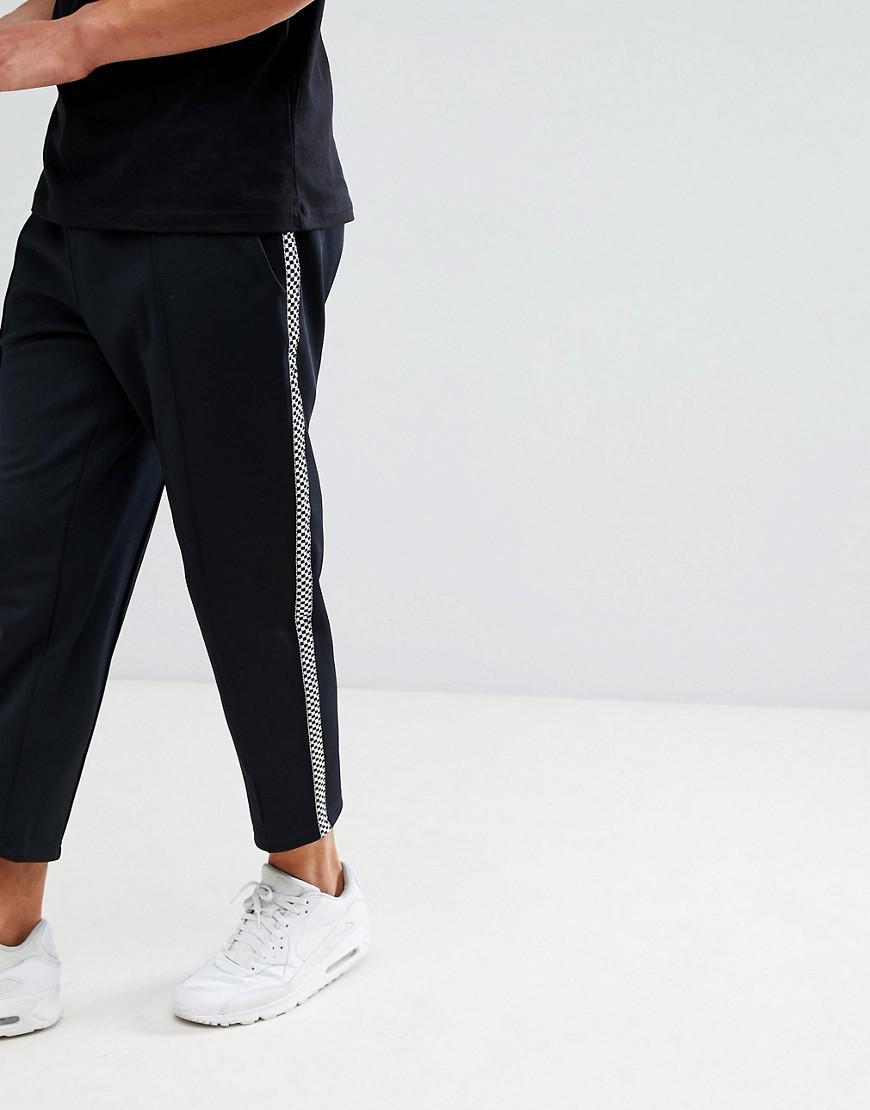 0af562e9894776 Lyst - Pantalon de jogging avec bandes carreaux sur les cts Only ...