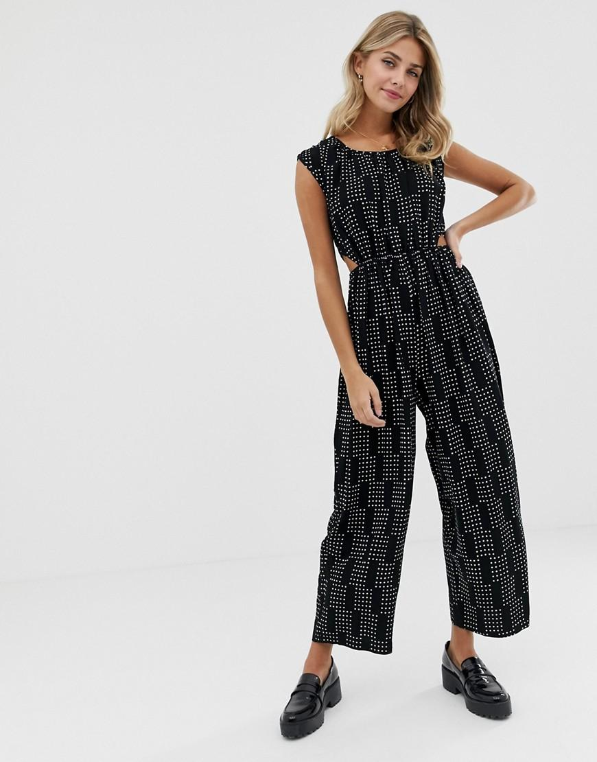 52470db33c4d Lyst - ASOS Cut Out Side Jumpsuit In Scatter Spot Print in Black