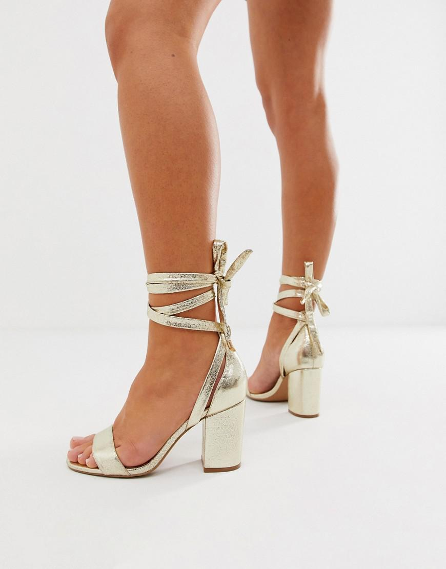 b30e8e2783bd Lyst - ASOS Wide Fit Howling Tie Leg Block Heeled Sandals in Metallic