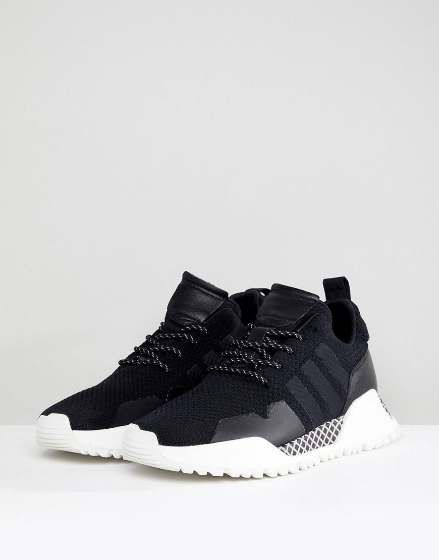 reputable site d7781 b4dee adidas Originals H.f1.4 Primeknit Sneakers In Black By9395 in Black for  Men - Lyst
