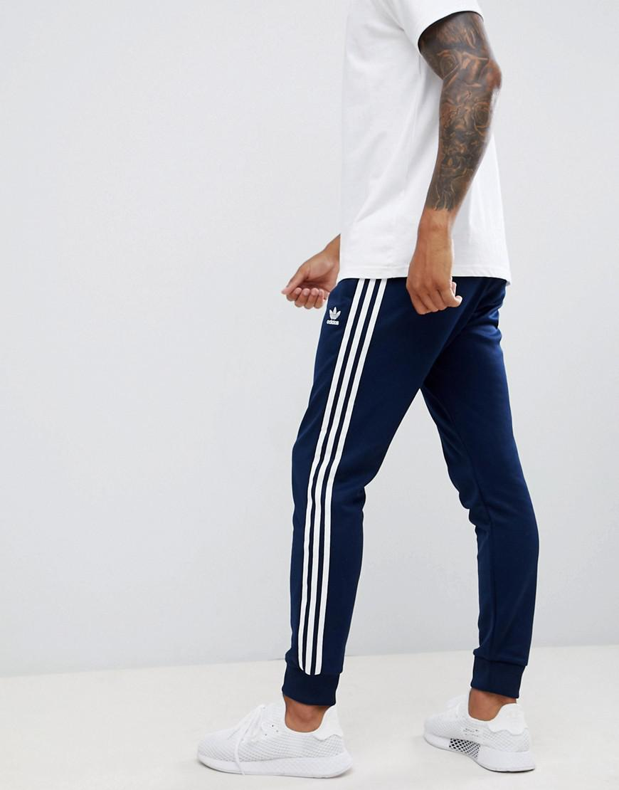 4e8d7dba8ace adidas Originals 3-stripe Skinny joggers With Cuffed Hem In Navy ...
