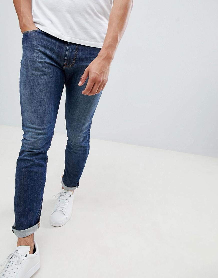 08857ef895775 Emporio Armani. Men s Blue J06 Slim Fit Stretch Denim 5 Pocket Jean In Mid  Wash