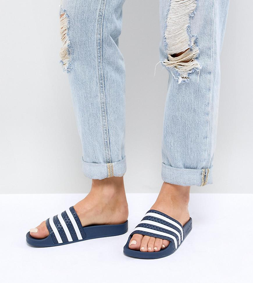 aad1f566e1279 adidas Originals. Women's Blue Adilette Slider Sandals In Navy And White