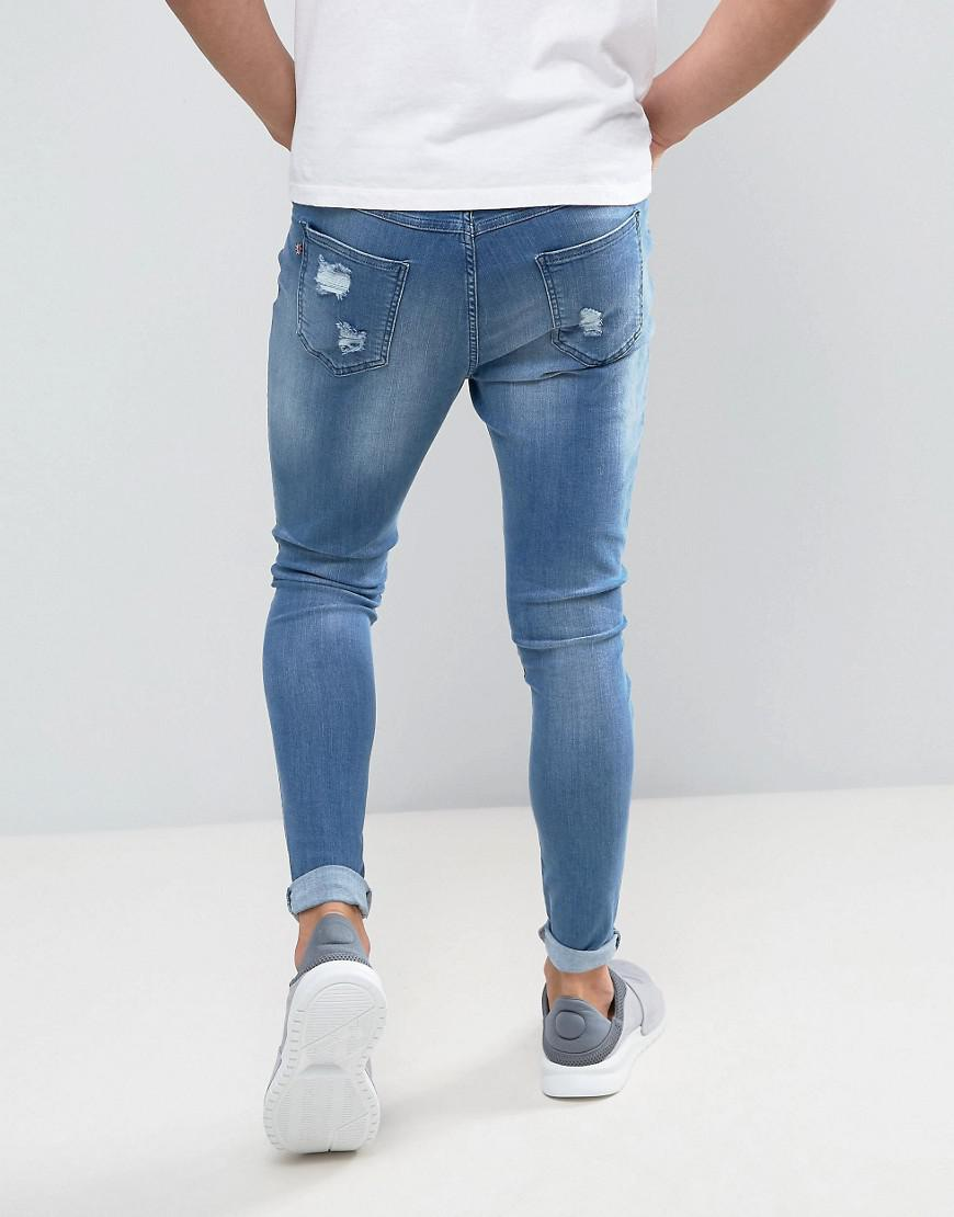 Super Skinny Jeans In Blue With Distressing - Blue Good For Nothing ZaBY75Oa
