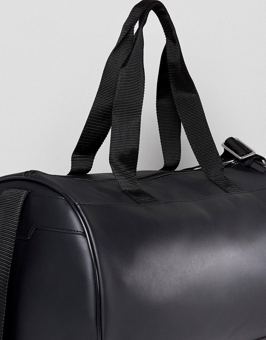 e398cce7ed1a1 Lacoste Leather Logo Holdall In Black in Black for Men - Lyst