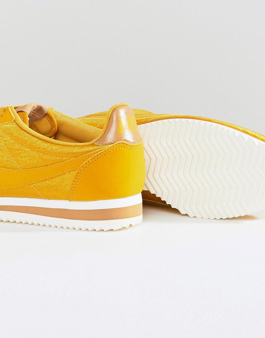 quality design 219f1 d740a ... get nike cortez satin nylon trainers in mustard yellow in yellow lyst  d73ef 90059
